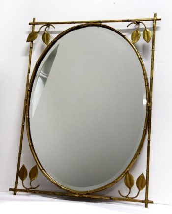 espejo ovalado vintage y biselado con marco de hierro